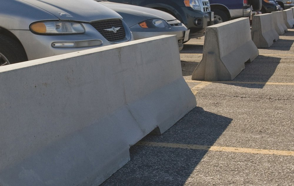 Precast Concrete Traffic And Safety Barriers In Parking Lot